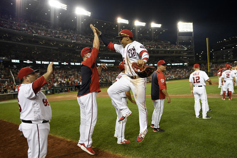 Washington Nationals' Juan Soto, center, leaps to celebrate after a baseball game against the Cleveland Indians, Saturday, Sept. 28, 2019, in Washington. (AP Photo/Nick Wass)