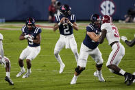 Mississippi quarterback Matt Corral (2) drops back to pass against during the first half of the team's NCAA college football game against Alabama in Oxford, Miss., Saturday, Oct. 10, 2020. (AP Photo/Rogelio V. Solis)