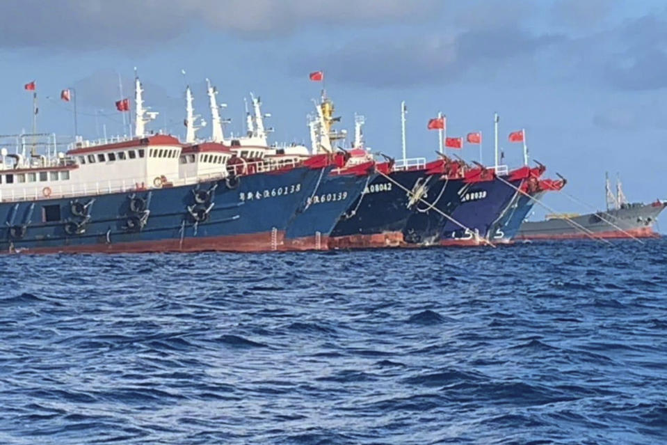 In this photo provided by the National Task Force-West Philippine Sea, Chinese vessels are moored at Whitsun Reef, South China Sea on March 27, 2021. The Philippine government said Wednesday, March 31, that more than 250 Chinese vessels it believes are operated by militia have been spotted near six Manila-claimed islands and reefs in the disputed South China Sea and demanded that China immediately remove them. (National Task Force-West Philippine Sea via AP)