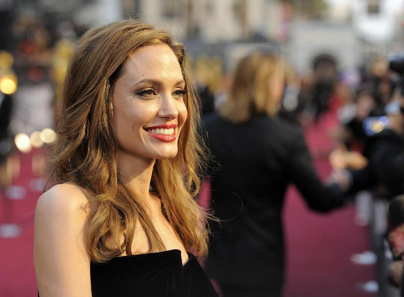 """FILE - This Feb. 26, 2012 file photo shows actress Angelina Jolie at the 84th Academy Awards in the Hollywood section of Los Angeles. Jolie says that she has had a preventive double mastectomy after learning she carried a gene that made it extremely likely she would get breast cancer. The Oscar-winning actress and partner to Brad Pitt made the announcement in an op-ed she authored for Tuesday's New York Times under the headline, """"My Medical Choice."""" She writes that between early February and late April she completed three months of surgical procedures to remove both breasts. (AP Photo/Chris Pizzello, file)"""
