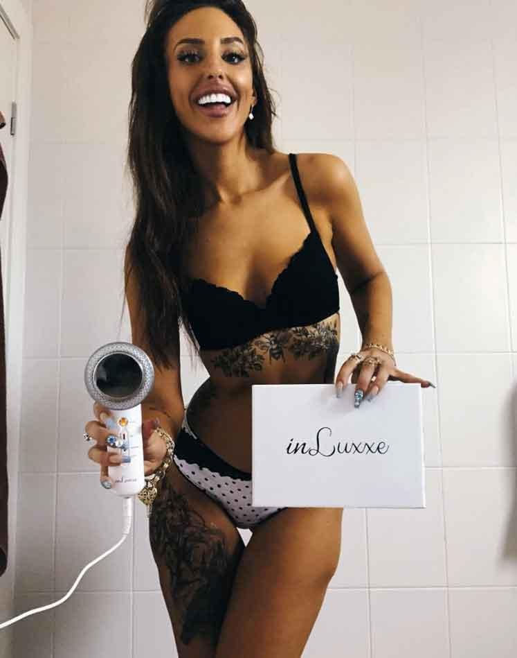 Lizzie promotes fat burning wand in lingerie