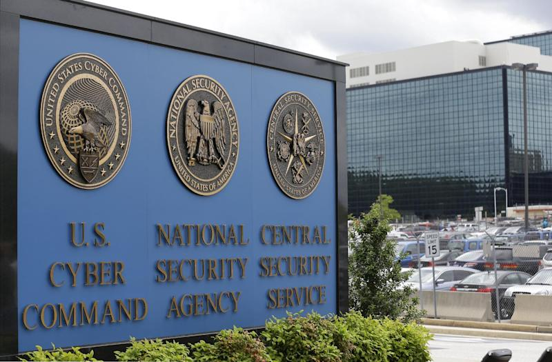 FILE - This June 6, 213 file photo shows the sign outside the National Security Agency (NSA) campus in Fort Meade, Md. The National Security Agency declassified three secret U.S. court opinions Wednesday, Aug. 21, 2013, showing how it scooped up as many as 56,000 emails and other communications by Americans with no connection to terrorism annually over three years, how it revealed the error to the court and changed how it gathered Internet communications. (AP Photo/Patrick Semansky, File)