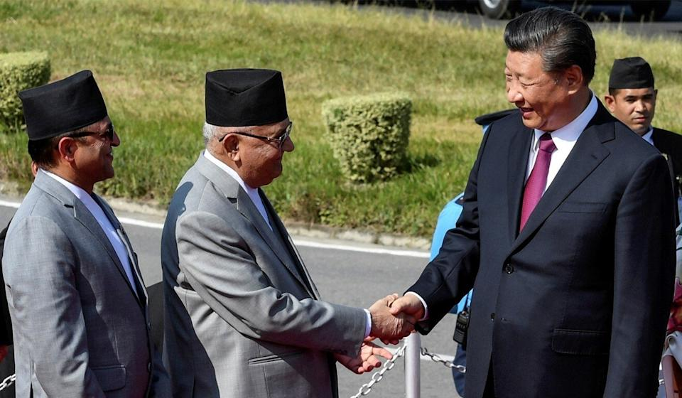Chinese President Xi Jinping shakes hands with Nepalese Prime Minister K.P. Sharma Oli during a visit to Kathmandu in 2019. Photo: Reuters