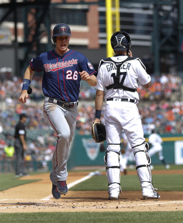 Minnesota Twins' Max Kepler (26) scores against the Detroit Tigers on a Jorge Polanco double in the first inning of a baseball game in Detroit, Saturday, June 8, 2019. (AP Photo/Paul Sancya)