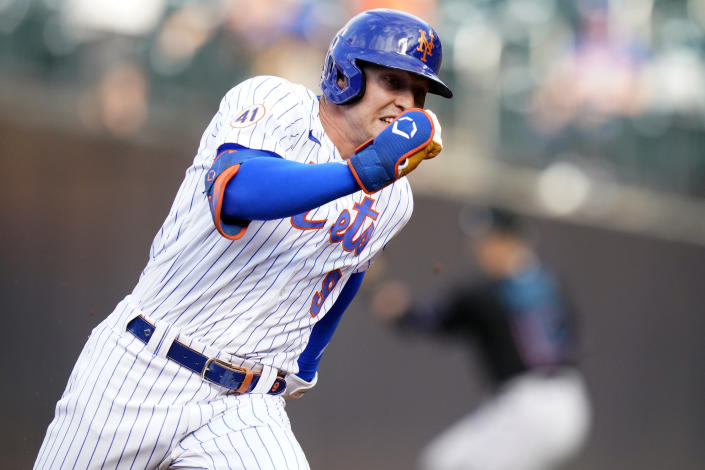 New York Mets' Brandon Nimmo (9) runs to third base for a triple during the first inning in the first baseball game of a doubleheader against the Miami Marlins, Tuesday, Sept. 28, 2021, in New York. (AP Photo/Frank Franklin II)