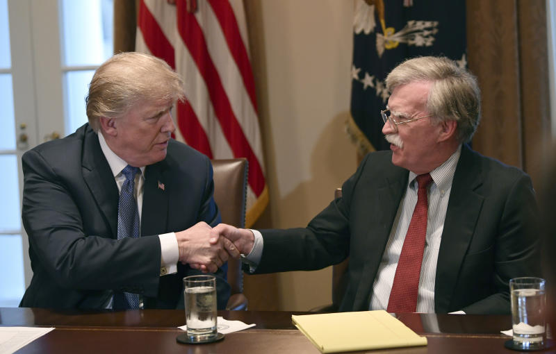 FILE - In this April 9, 2018 file photo, President Donald Trump, left, shakes hands with national security adviser John Bolton in the Cabinet Room of the White House in Washington at the start of a meeting with military leaders.  Trump has fired national security adviser John Bolton. Trump tweeted Tuesday that he told Bolton Monday night that his services were no longer needed at the White House.  (AP Photo/Susan Walsh)