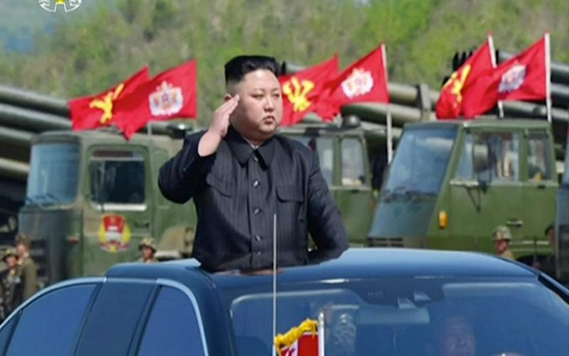 Video broadcast in a news bulletin by North Korea's KRT on Wednesday showed Kim Jong-un at the celebration - Credit: KRT