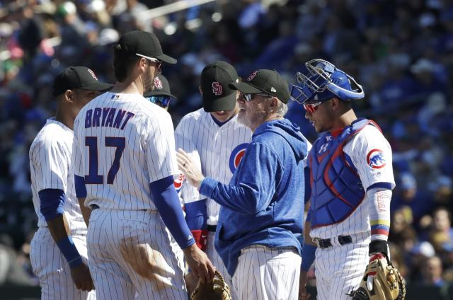 Chicago Cubs manager Joe Maddon makes a mound visit during the second inning of the team's spring training baseball game against the Texas Rangers, Saturday, Feb. 24, 2018, in Mesa, Ariz. (AP Photo/Carlos Osorio)