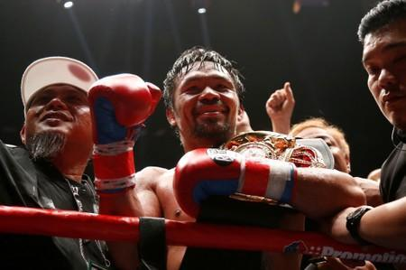 FILE PHOTO: Manny Pacquiao celebrates after winning a bout against Lucas Matthysse at the Axiata Arena, Kuala Lumpur, Malaysia