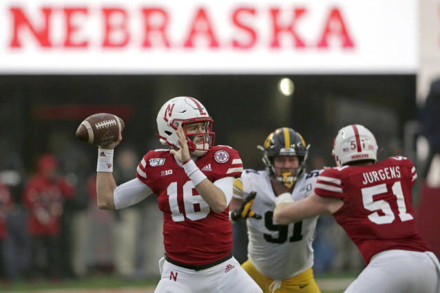 Nebraska QB Noah Vedral (16) throws during the first half of a college football game on Nov. 29. (AP)