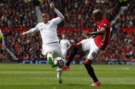 Britain Football Soccer - Manchester United v Swansea City - Premier League - Old Trafford - 30/4/17 Swansea City's Martin Olsson in action with Manchester United's Ashley Young Action Images via Reuters / Jason Cairnduff Livepic