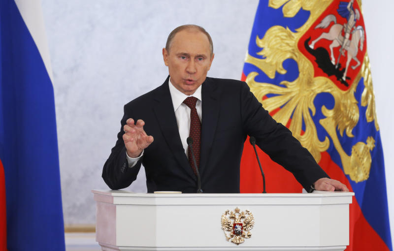 Russian President Vladimir Putin speaks during a state-of-the nation address  in Moscow,  Russia, Wednesday, Dec. 12, 2012. Putin delivered his first state-of-the nation address since winning a third term in March's election despite a wave of massive protests in Moscow. Putin has taken a tough course on dissent since his inauguration, with opposition activists arrested and introduction of laws that impose heavy fines on protesters.Putin said Wednesday that the government would focus on developing high-tech industries to make sure that Russia succeeds in global competition. (AP Photo/Alexander Zemlianichenko)