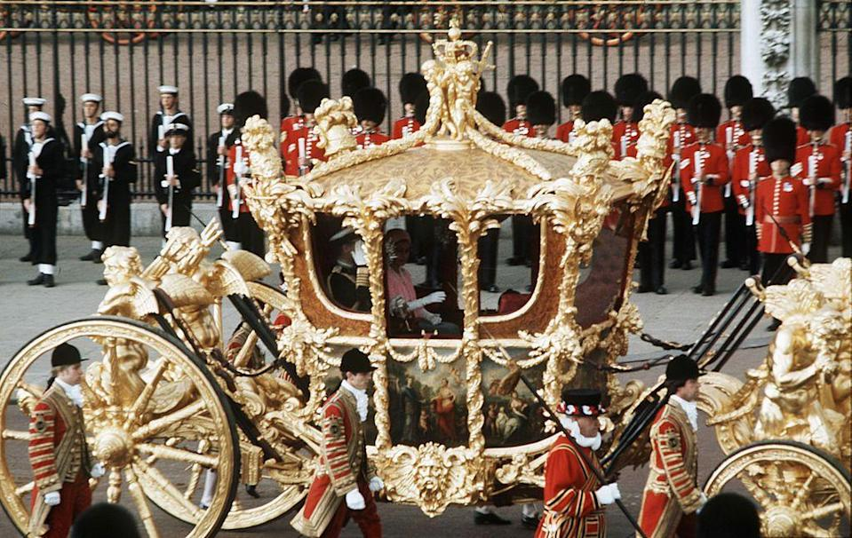 <p>Queen Elizabeth II rides in her Golden coach with Prince Philip during her Silver jubilee celebration.</p>