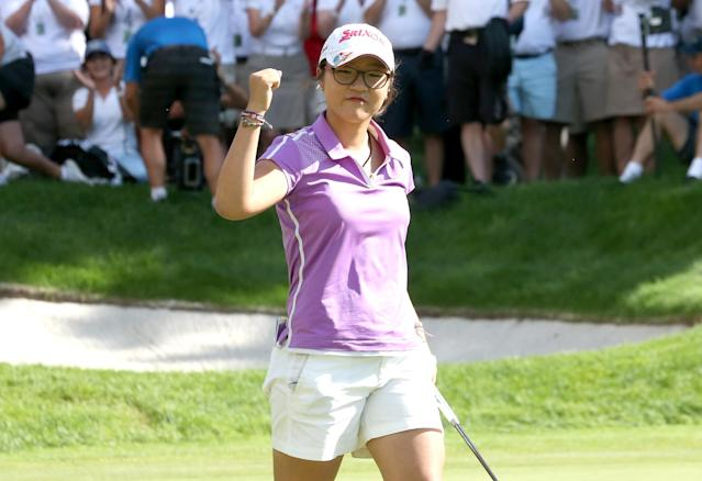 EDMONTON, AB - AUGUST 25: Lydia Ko of New Zealand celebrates after making a birdie putt on the 18th hole to cement her five stroke victory during the final round of the CN Canadian Women's Open at Royal Mayfair Golf Club on August 25, 2013 in Edmonton, Alberta, Canada. (Photo by Stephen Dunn/Getty Images)