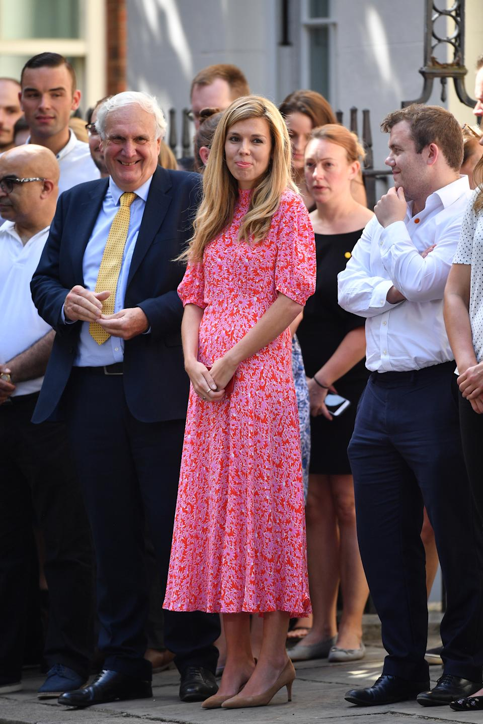 Carrie Symonds wearing a Ghost dress on Downing Street in July [Photo: Getty Images]