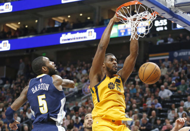 "<a class=""link rapid-noclick-resp"" href=""/nba/players/4718/"" data-ylk=""slk:Derrick Favors"">Derrick Favors</a> throws one down against the Nuggets on Tuesday. (AP)"