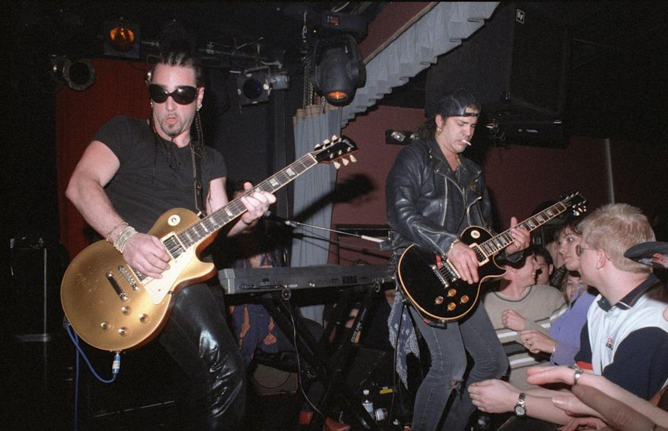 <p>Slash and Danny Saber play guitar at the Viper Room for the Jim Dunlop party in Los Angeles, California in 1999.</p>