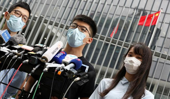 Nathan Law (left), Joshua Wong and Agnes Chow of the opposition political group Demosisto speak to the press outside Hong Kong's Legislative Council on Thursday. Photo: K.Y. Cheng