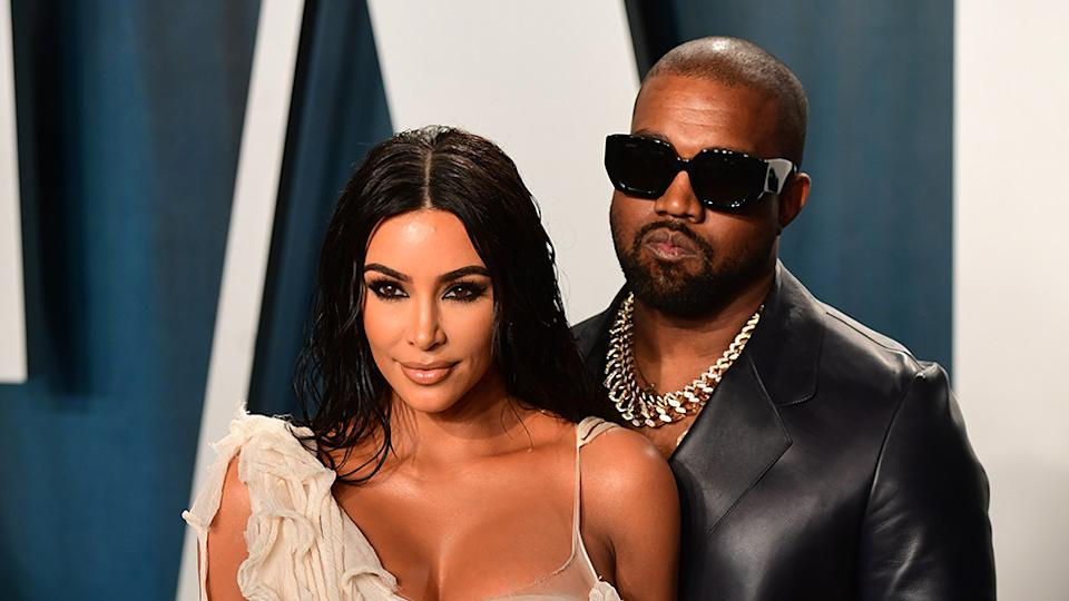 Kim Kardashian and Kanye West pose on the red carpet
