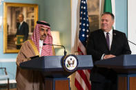 FILE - In this Oct. 14, 2020 file photo, Secretary of State Mike Pompeo, right, listens to Saudi Minister of Foreign Affairs Prince Faisal bin Farhan Al Saud speaks during their meeting at the State Department, in Washington. While many nations have sent congratulatory messages to President-elect Joe Biden, so far Saudi Arabia remains silent. Biden has promised to end U.S. support for the kingdom's war in Yemen. (AP Photo/Manuel Balce Ceneta, Pool, File)