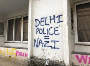 In this Wednesday, Dec. 18, 2019 photo, graffiti cover the wall of a building at Jamia Millia Islamia University in New Delhi, India. Students of this New Delhi university have turned the campus' sandstone walls into a canvas of discontent. The spray-painted slogans and symbols reflect their opposition to a new law that provides a path to citizenship for religious groups from neighboring countries except Muslims. (AP Photo/Sheikh Saaliq)