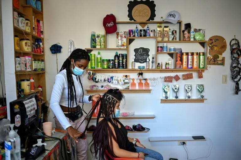 Hair and race identity are closely intertwined in Venezuela (AFP/Federico PARRA)