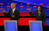 FILE - In this July 31, 2019, file photo, then-Democratic presidential candidate Sen. Kamala Harris, D-Calif., and Democratic presidential candidate former Vice President Joe Biden participate in the second of two Democratic presidential primary debates at the Fox Theatre in Detroit. Biden has chosen Harris as his running mate. (AP Photo/Paul Sancya, File)