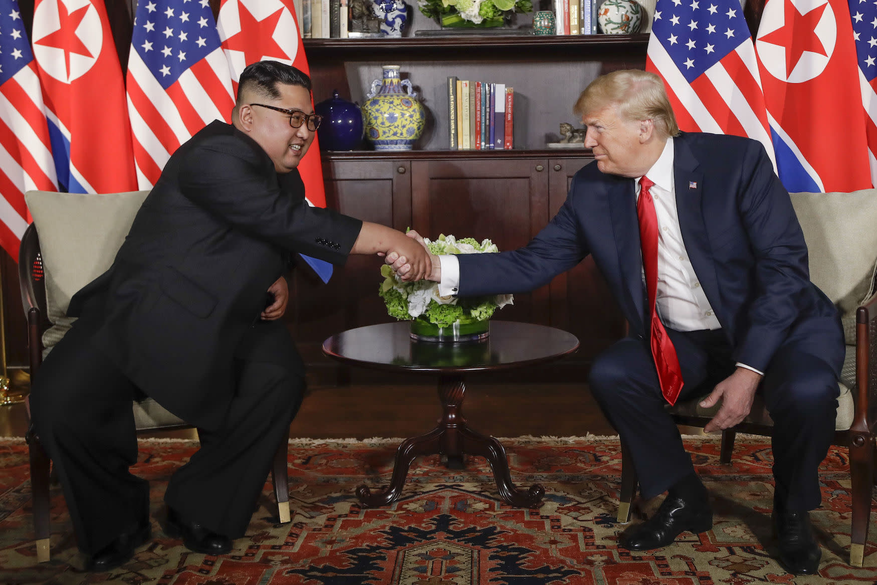 Historic moment: Kim Jong-un and Donald Trump shake hands in Singapore during their landmark meeting. (AP)