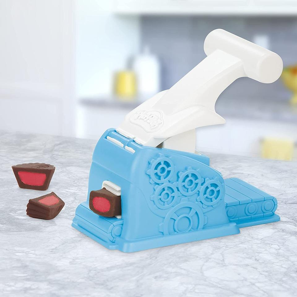 """You can't have all that Play-Doh and not have the proper instruments to turn it into different types of sweet clay-based confections.<br /><br /><strong>Get it from Amazon for <a href=""""https://www.amazon.com/dp/B07ZYCB7S2?tag=huffpost-bfsyndication-20&ascsubtag=5709944%2C27%2C32%2Cd%2C0%2C0%2C0%2C962%3A1%3B901%3A2%3B900%3A2%3B974%3A3%3B975%3A2%3B982%3A2%2C13752214%2C0"""" target=""""_blank"""" rel=""""noopener noreferrer"""">$14.99</a>.</strong>"""