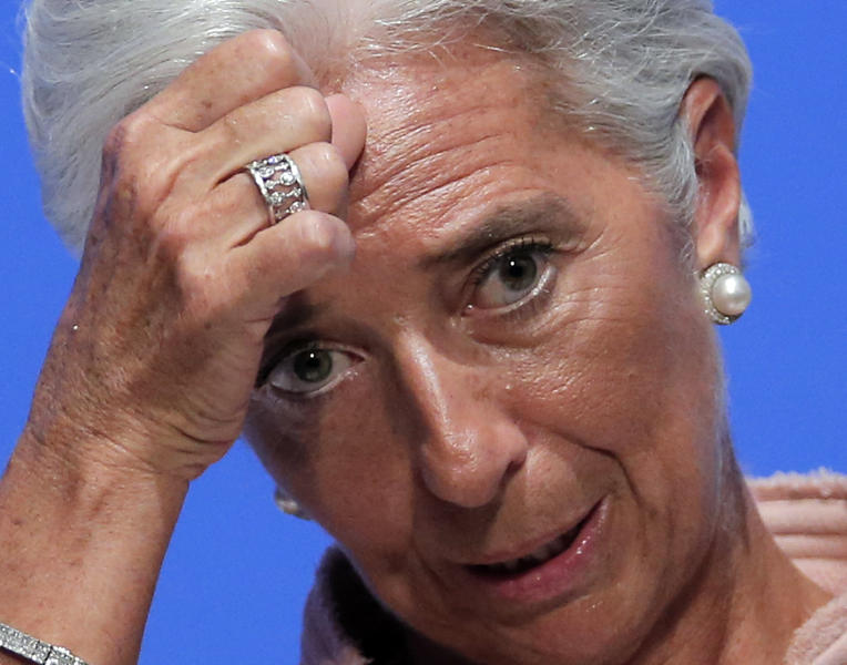 IMF Managing Director Christine Lagarde gestures during her speech at a forum for the annual meetings of the IMF and World Bank Group at a Tokyo hotel Friday, July 6, 2012. Lagarde has praise for Japan's move to raise its sales tax to curb the swollen national debt. (AP Photo/Itsuo Inouye)
