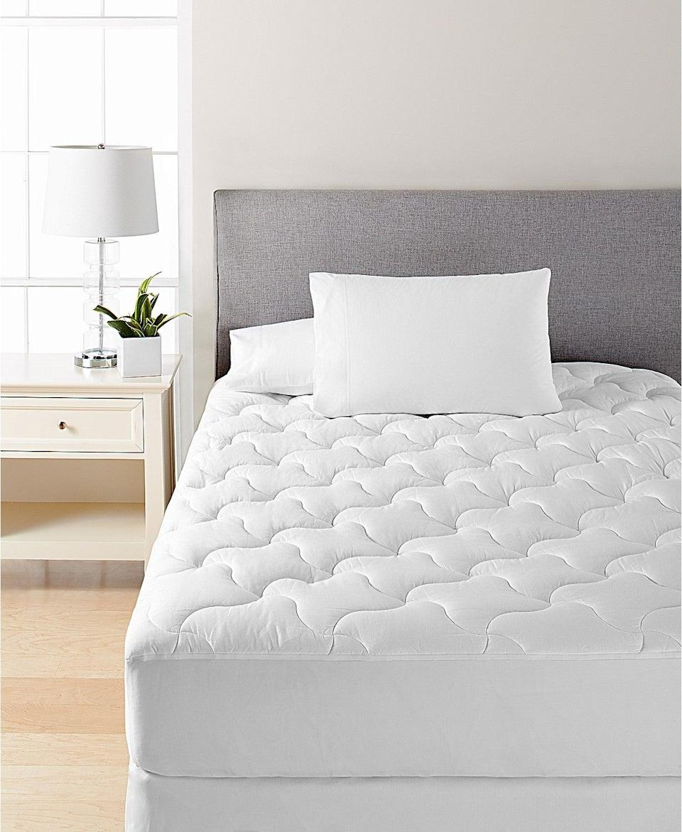 """<h3>Dream Science By Martha Stewart Quilted Mattress Pad</h3><br><strong>Best For: Classic Comfort</strong><br>The price is definitely right on this super-soft classic quilted mattress topper from the OG herself, Martha. <br><br><strong>The Hype: 4.4 out of 5 stars</strong><br><br><strong>Sleepers Say:</strong> """"To me, this is a perfect mattress pad; it is soft and has a nice thickness to it. It fits my full mattress perfectly. I highly recommend."""" – <em>Arlene, Macy's Reviewer</em><br><br><em>Shop </em><strong><em><a href=""""https://www.macys.com/shop/featured/martha-stewart-collection"""" rel=""""nofollow noopener"""" target=""""_blank"""" data-ylk=""""slk:Dream Science By Martha Stewart"""" class=""""link rapid-noclick-resp"""">Dream Science By Martha Stewart</a></em> </strong><br><br><strong>Dream Science by Martha Stewart Collection</strong> Quilted Mattress Pad, $, available at <a href=""""https://go.skimresources.com/?id=30283X879131&url=https%3A%2F%2Fwww.macys.com%2Fshop%2Fproduct%2Fmartha-stewart-collection-quilted-mattress-pad-created-for-macys%3FID%3D5085340%26CategoryID%3D40384"""" rel=""""nofollow noopener"""" target=""""_blank"""" data-ylk=""""slk:Macy's"""" class=""""link rapid-noclick-resp"""">Macy's</a>"""