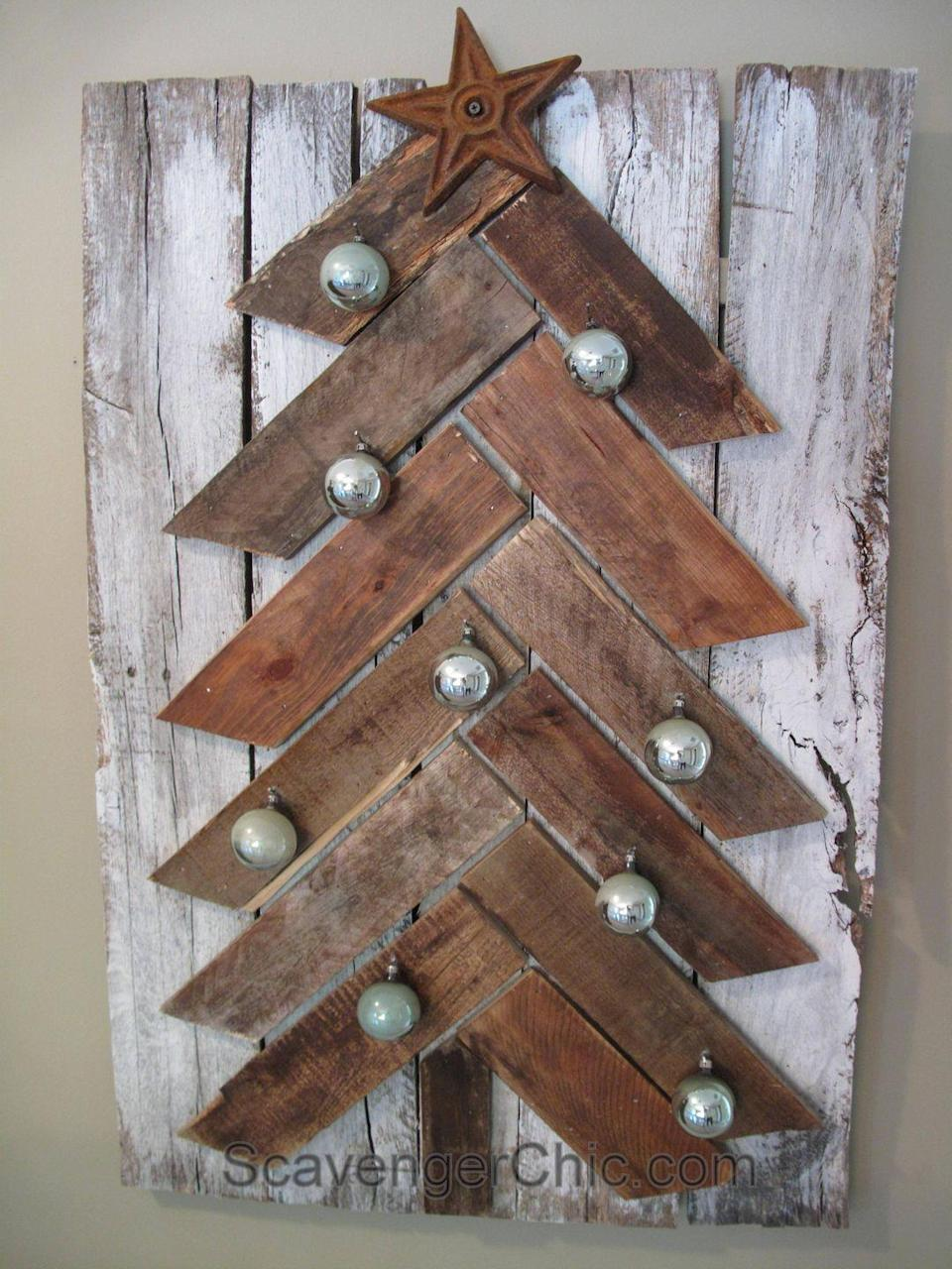 """<p>While this stylish pallet tree could be decorated with almost anything, we love the vintage grayish-green Christmas ornaments. The white-washed backing board provides a nice contrast to the plain wood of the tree, too.</p><p><strong>Get the tutorial at <a href=""""https://scavengerchic.com/2014/11/23/pallet-wood-christmas-tree-diy/"""" rel=""""nofollow noopener"""" target=""""_blank"""" data-ylk=""""slk:Scavenger Chic"""" class=""""link rapid-noclick-resp"""">Scavenger Chic</a>.</strong></p><p><a class=""""link rapid-noclick-resp"""" href=""""https://www.amazon.com/Best-Sellers-Industrial-Scientific-Finishing-Nails/zgbs/industrial/17724327011?tag=syn-yahoo-20&ascsubtag=%5Bartid%7C10050.g.23322271%5Bsrc%7Cyahoo-us"""" rel=""""nofollow noopener"""" target=""""_blank"""" data-ylk=""""slk:SHOP FINISHING NAILS"""">SHOP FINISHING NAILS</a><br></p>"""