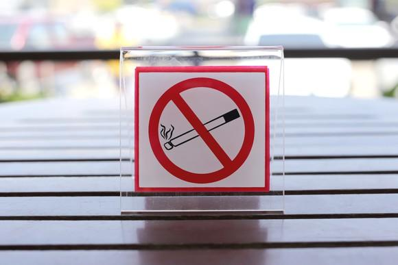 """A """"no smoking"""" sign on a table."""