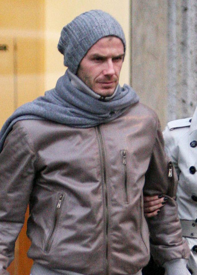 """Sexy soccer star David Beckham scores in a gray and brown ensemble as he and wife Victoria mingle in Milan. LaPresse/<a href=""""http://www.x17online.com"""" target=""""new"""">X17 Online</a> - January 22, 2010"""