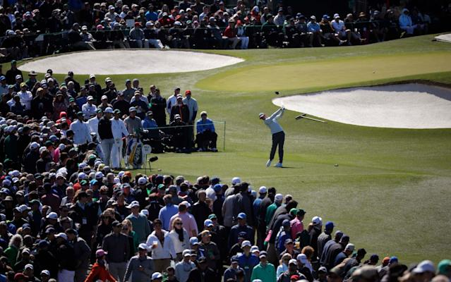 <span>The crowds follow Rory McIlroy</span> <span>Credit: REUTERS </span>