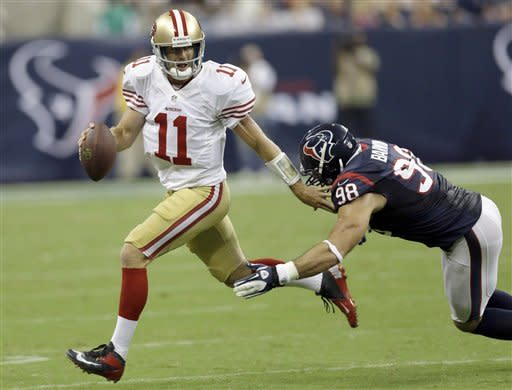 San Francisco 49ers quarterback Alex Smith (11) scrambles away from Houston Texans outside linebacker Connor Barwin (98) in the second quarter an NFL preseason football game Saturday, Aug. 18, 2012, in Houston. (AP Photo/David J. Phillip)