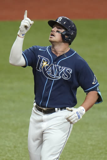 Tampa Bay Rays' Hunter Renfroe celebrates his grand slam off Toronto Blue Jays starting pitcher Hyun-Jin Ryu during the second inning of Game 2 of an American League wild-card baseball series Wednesday, Sept. 30, 2020, in St. Petersburg, Fla. (AP Photo/Chris O'Meara)
