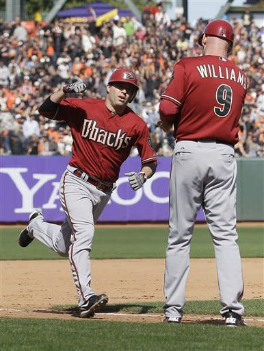 Arizona Diamondbacks' John McDonald, left, is congratulated by third base coach Matt Williams (9) after hitting a solo home run off of San Francisco Giants pitcher Barry Zito during the eighth inning of a baseball game in San Francisco, Monday, May 28, 2012. (AP Photo/Jeff Chiu)