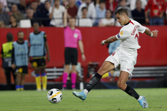 FILE - In this Oct. 3, 2019, file photo, Sevilla's Javier Hernandez shoots, but fails to score, during a Europa League group A soccer match against APOEL Nicosia at the Estadio Ramon Sanchez-Pizjuan stadium in Seville, Spain. The Los Angeles Galaxy have signed Javier Chicharito Hernndez to a Designated Player contract, the MLS soccer club announced Tuesday, Jan. 21, 2020. (AP Photo/Miguel Morenatti, File)