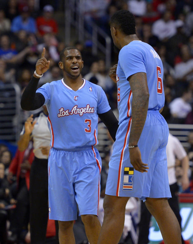 Los Angeles Clippers guard Chris Paul, left, gestures to center DeAndre Jordan during the first half of an NBA basketball game against the Philadelphia 76ers, Sunday, Feb. 9, 2014, in Los Angeles. (AP Photo/Mark J. Terrill)