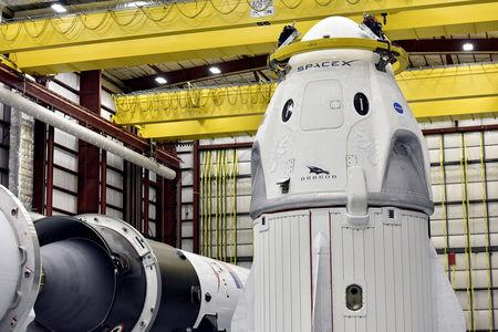 FILE PHOTO: The Dragon crew capsule sits in the SpaceX hangar at Launch Complex 39-A, where the space ship and Falcon 9 booster rocket are being prepared for a January 2019 launch at Cape Canaveral, Florida, U.S. December 18, 2018. REUTERS/Steve Nesius