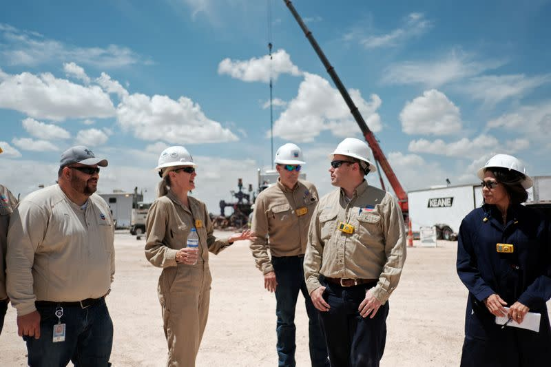 FILE PHOTO: Chevron personnel work at an oil exploration drilling site near Midland