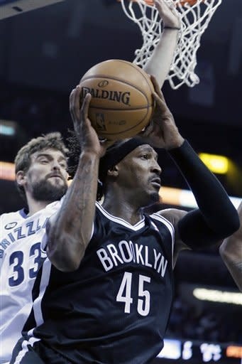 Memphis Grizzlies' Marc Gasol (33), of Spain, defends against Brooklyn Nets' Gerald Wallace (45) during the first half of an NBA basketball game in Memphis, Tenn., Friday, Jan. 25, 2013. (AP Photo/Danny Johnston)
