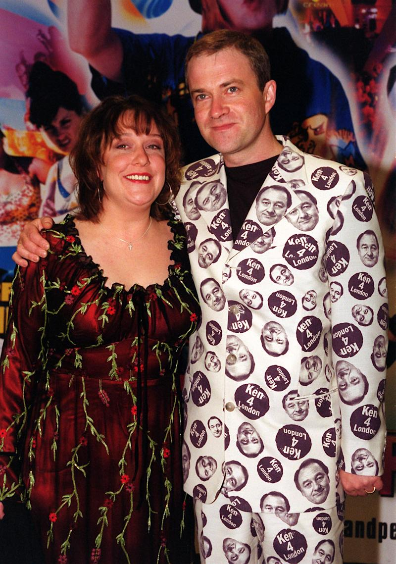 Comic Harry Enfield and co-star Kathy Burke arriving at the World Charity Premiere of their film 'Kevin and Perry Go Large' in aid of Comic Relief, which was screened at the Warner Village West End in London's Leicester Square. * Enfield turned up in an outfit emblazoned with his support for London mayoral candidate Ken Livingstone, the latest showbiz star to pledge allegiance to Mr Livingstone. (Photo by Tony Harris - PA Images/PA Images via Getty Images)