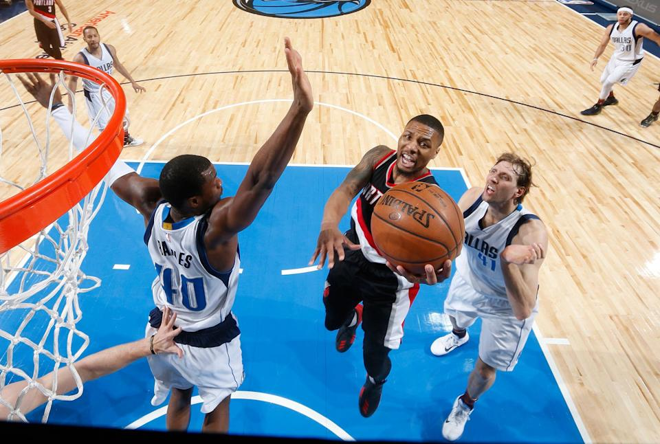 Damian Lillard's Blazers and the Dirk Nowitzki-and-Harrison Barnes-led Mavericks are two of six teams vying for one playoff spot. (Getty Images)
