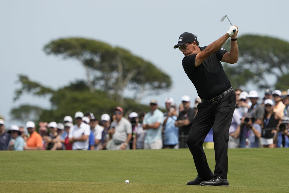 Phil Mickelson works on the second hole during the third round at the PGA Championship golf tournament on the Ocean Course, Saturday, May 22, 2021, in Kiawah Island, S.C. (AP Photo/David J. Phillip)