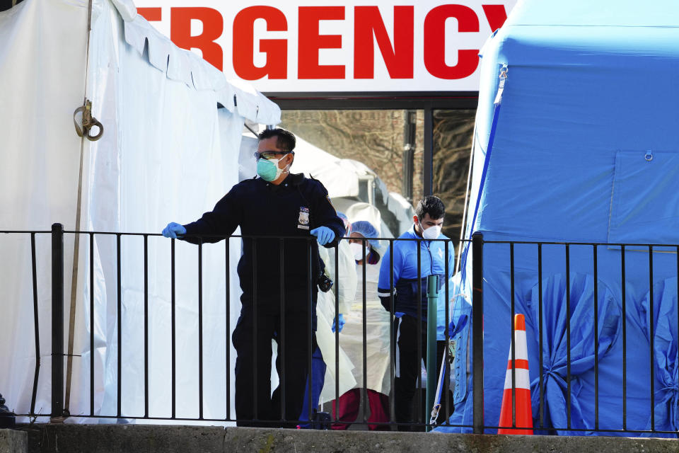 Photo by: John Nacion/STAR MAX/IPx 2020 3/27/20 Medical Workers and Police are seen at Elmhurst Hospital in Queens, New York while a large Thank You Sign is placed outside for all those health care professionals who have labored tirelessly while risking their own lives to help others.