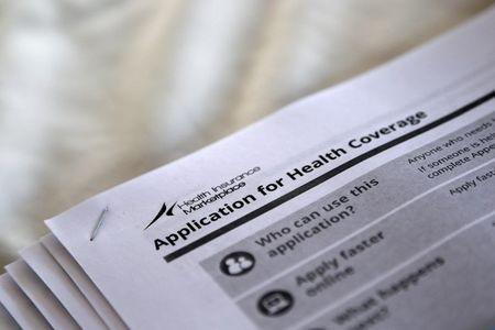 FILE PHOTO: Applications are seen at a rally held by supporters of the Affordable Care Act in Jackson Mississippi
