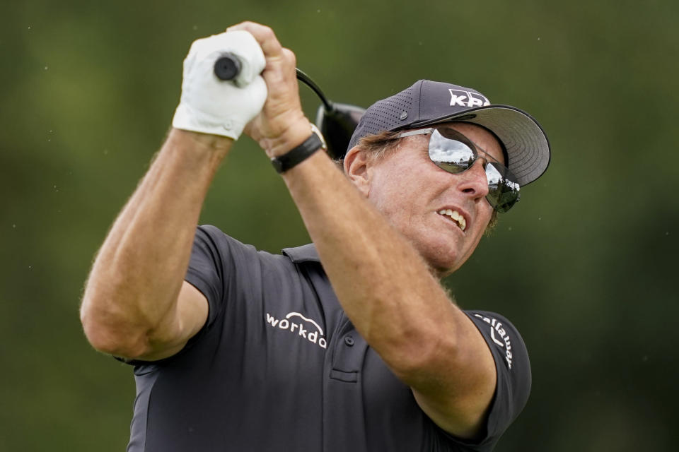 Phil Mickelson watches his shot off the 16th tee in the first round of play at the Northern Trust golf tournament, Thursday, Aug. 19, 2021, at Liberty National Golf Course in Jersey City, N.J. (AP Photo/John Minchillo)