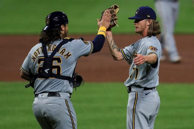 Brewers rally in 7th, bolster chances with 3-2 win over Reds